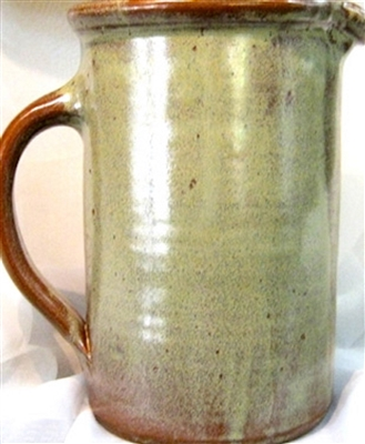"Traditions Pottery handmade Large water pitcher. Great for ice tea, water, lemonade, and other liquids. About 10"" tall. Holds about 1.5 quarts. Also works wonderfully for utensils, flower vase,  and as a wine chiller."