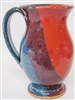 "Traditions Pottery handmade footed mug. Great for coffee, tea, lattas. They are app. 5 1/2"" tall x 3"" across the top. They hold 14 ounces. Oven, Microwave, and dishwasher safe. Great for hot or cold liquids. 