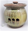 This Traditions Pottery garlic keeper is a great way to store cloves of garlic.  Garlic will stay fresher , longer in the pottery jar. Come with lid and holes on each side.  Microwave, oven, and dishwasher safe. Scroll design