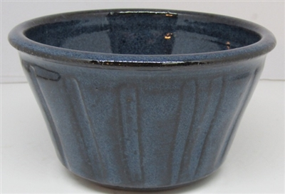 Small ramkin bowl for nuts, pudding, ice cream and more. Stacks in cabinet, and nests nicely. Microwave, oven, and dishwasher safe. Made by Janet Calhoun of Traditions Pottery,  Holds 8 ounces  2x3.,5