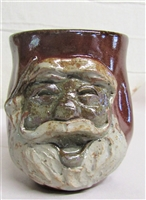 Traditions Pottery Handmade Santa Claus Face cup, by Michael Calhoun of  Blowing Rock, NC  Burgandy with natural clay for face.  Electric fired. Wheel thrown, hand sculpted.