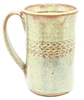 "Traditions Pottery Handmade pottery mug, Holds 16 ounces. Has ""scroll"" ring just below top of mug.  Oven, Microwave, and dishwasher safe. Coffee, tea, hot or cold liquids. 5"" tall x 3.5"" across the top. Wheel thrown"